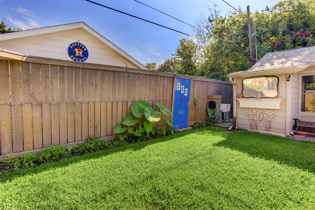 How great is this back yard green space!  Behind the converted garage is additional space for storing outside equipment.