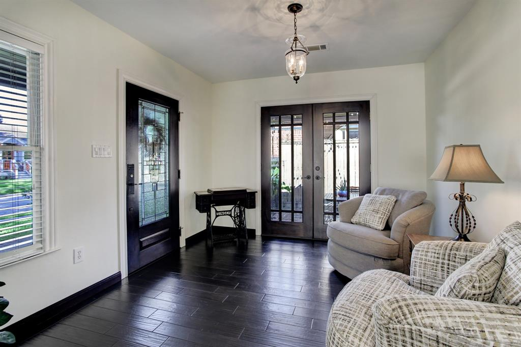 Just inside the front door  is entry space big enough to be used as a reading nook.  As well the double doors lead to a paver side patio.