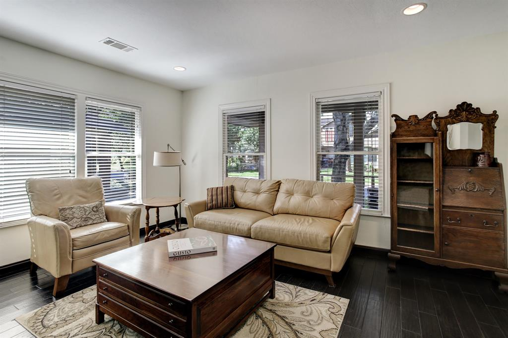 The living room looks out onto Pizer St. and is filled with natural light.