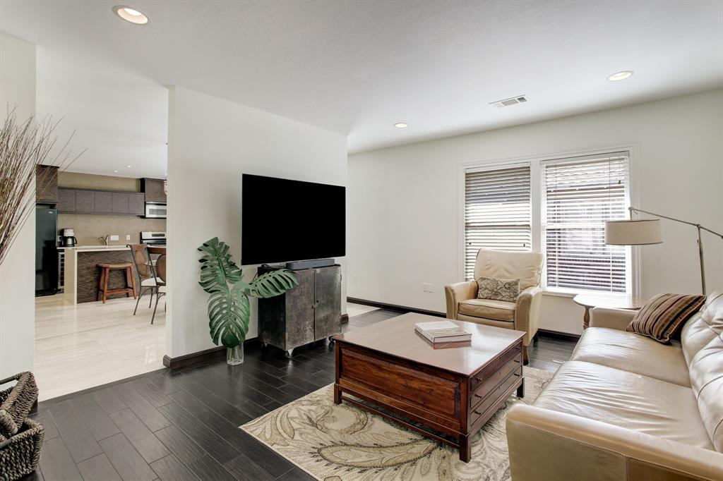 The flow of this floor plan is excellent, with a partial wall separating the living room from the eat-in kitchen (accessible from either side of the TV wall).