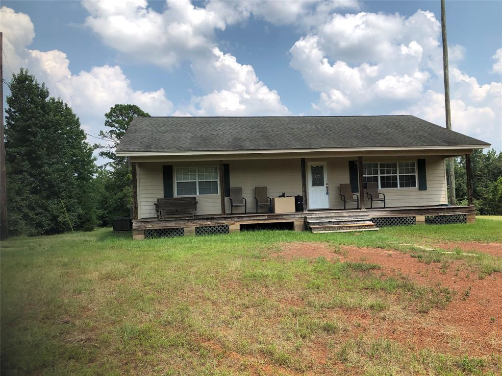 Hidden Jewell in Central Heights Schools. Very secluded 2br/1.5 bth home sitting on 17.54 acres just off FM 2864. The land is beautiful with rolling pastures, pines and hardwoods, a pond, and a 30 x 40 shop with roll top door. The acreage produces enough grass to support animals while the woods are thick enough to attract a different kind of animal. This is a unique opportunity. There aren't many properties like this one left.