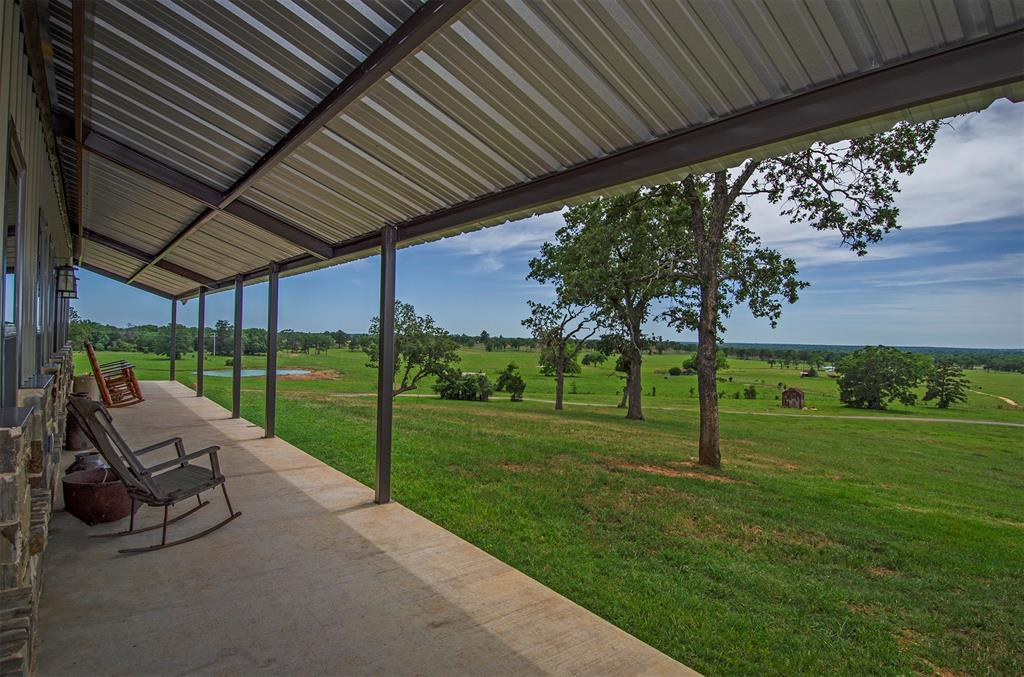 Picturesque countryside views featuring ±366.16 acres. Beautiful rolling terrain with 100' in elevation change, reaching its peak at 420'. Conveniently located only 26 miles to College Station. This property truly has it all with mature scattered trees, heavily wooded areas, 9 ponds, potential lake site(s) & seasonal creek. Abundant wildlife, private & peaceful setting. Custom gated entry, paved asphalt drive & barndominium, just built in 2019. ±1800 SF, extensive covered porches w/ incredible views. 2 br, 2 baths, spacious island kitchen, vaulted ceilings, stone fireplace & open plan great for entertaining. Rear entry 2+ car attached garage, barns & cattle pens. Additional hilltop homesites also capturing these panoramic views while being secluded from the existing structures if desired. Perimeter and cross-fenced, current ag-exemption in place. Property is unrestricted with county maintained road frontage. Amazing one-of-a-kind property and great location.