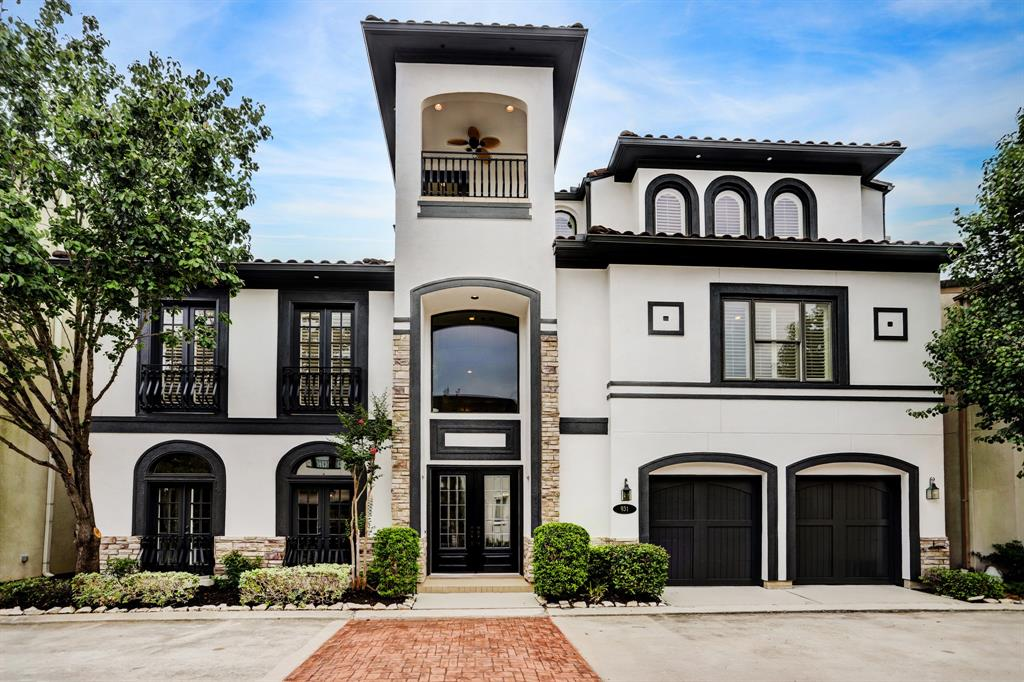Exquisite 3 story home w 3rd floor patio & sprawling backyard that is sure to impress w multiple patios, large custom brick fireplace w wood storage & candle nooks, & large green space that could fit a pool, all located in a gated community zoned to SBISD! First floor feat large, open living room w stone hearth, dining room w dry bar, & spacious study or media rm. Impressive kitchen boasts Carrara marble counters/backsplash, SS appliances incl double oven & wine fridge, 2 walk-in pantries, pot filler, apron sink & island w breakfast bar. Pwdr bath under grand stairs. Second floor w 3 bed rms & utility room w sink. Primary suite feat tray ceiling, french windows, wood floors w carpet inlay, & oversized en suite w dbl vanities, jetted tub, sep standing shower, & huge closet. Two secondary beds each w full en suite bath. Third story features spacious game room or 4th bedroom w/ wet bar, wine fridge, hardwood floors, full en suite bath, & rooftop terrace. Elevator ready.