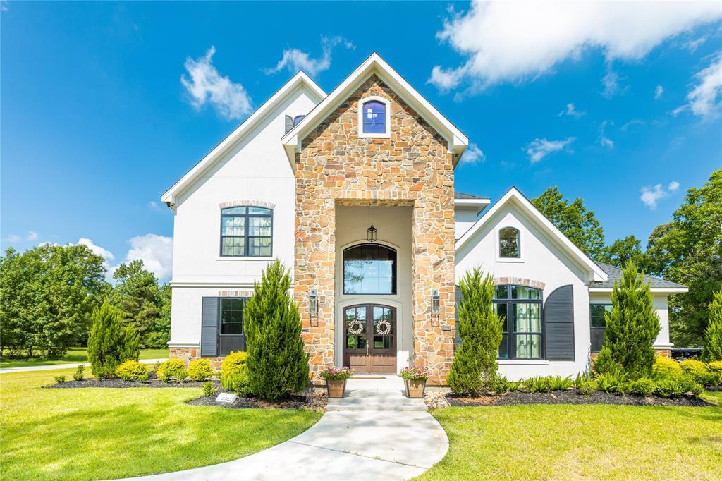 This custom built contemporary home sits on a 1.54 acre homesite in Montgomery Trace. Offering the design and style of today, this nearly new home features an outstanding floor plan of thoughtful open-family living, high ceilings, and abundant natural light. Home life is centered around the large family room, gourmet kitchen, breakfast table, and entertainment ready outdoor patio leading to a resort style heated water pool/spa. With 4 bedrooms, all with their own bath, the large Primary Suite and second bedroom located on first floor. Study can be converted to dining room. This home has been set up for surround sound throughout the whole bottom floor. Full wet bar and ADA touches is just some of the perks, must come to see it all. Great location, increasingly desirable area, low tax rate and zoned to 5 Star Montgomery Schools. Within minutes of two lake parks for picnics and fishing.