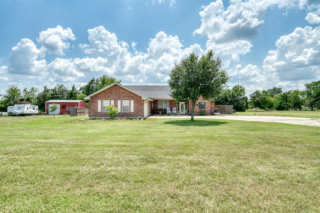 Location, location, location! Do not miss out on this 3 bedroom, 2 bathroom home on 2 acres right off of FM 1179. Walking into the home you will find an open living area, formal dining or bonus room. Double doors will lead you outside from the living/family room. Split floor plan with a large master bedroom. Master bathroom has a tub, and shower, with plenty of counter space. The guest bedrooms are a great size, and will share the second bathroom. Enjoy the newly poured patio, overlooking your backyard with above ground swimming pool! The property has a large barn, and all the space you need to make it yours! You can't beat this location allowing for country feel, while having ALL of the city conveniences.