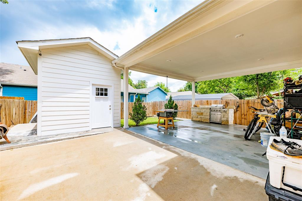 The spacious storage shed and covered carport.