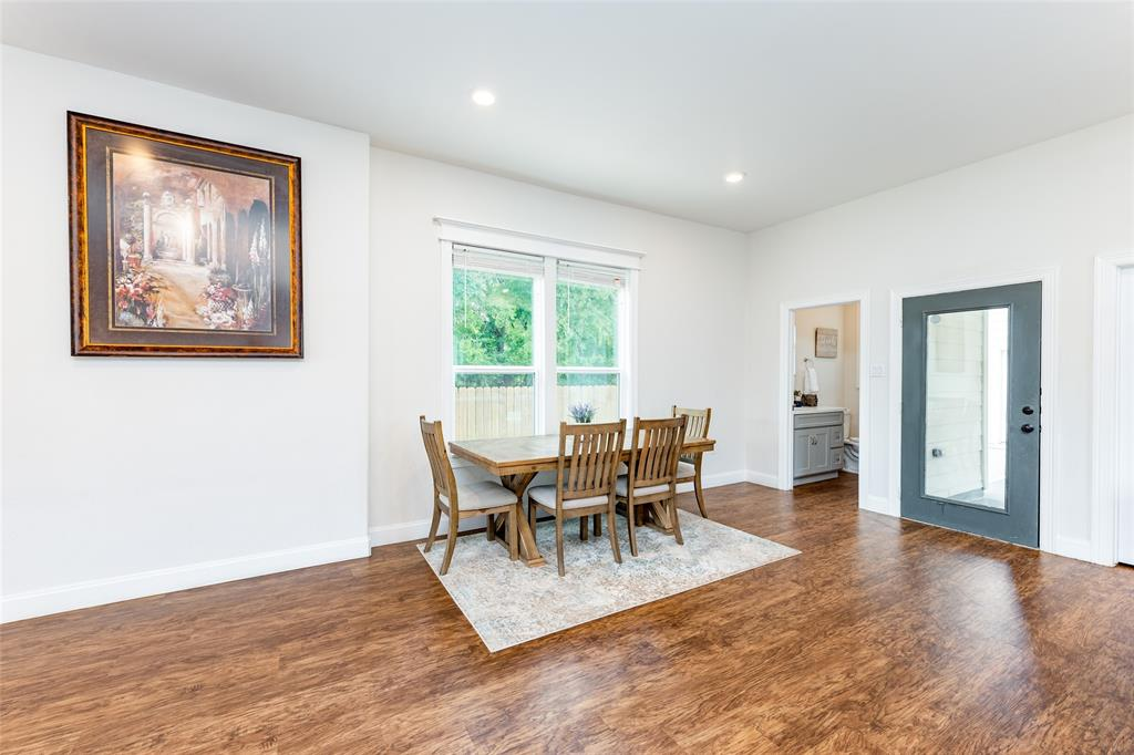 The spacious dining area leads to the backyard.