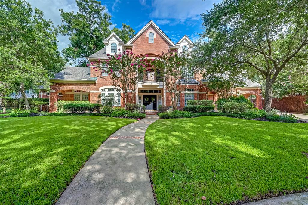 Step into this stately custom Georgian home built with uncompromised quality by Chuck Morris.  With 5751 Sq ft.(per appraiser) this 5 bedroom (4 1/2 baths) beauty has 2 studies, a huge game room, a 3rd floor hobby room/exercise room (280 sq ft.), and endless architectural details. The entertaining kitchen w/double oven/warming tray, ice maker, granite counters, & custom cabinets that open to the family room,  plantation shutters, hardwood floors throughout the downstairs, & tile in all bathrooms, a private cul de sac lot w/a 50' heated lap pool, spa, & fountain & outdoor kitchen. The outdoor kitchen features a hibachi grill, infrared gas grill and a single gas burner. Custom built intercom, stereo system & security camera, ring doorbell.  The upstairs balcony overlooks the spacious yard w/ pecan trees & mosquito misting system. A new roof was completed 7/30/21!  Dont miss this incredible opportunity to own a piece of paradise!