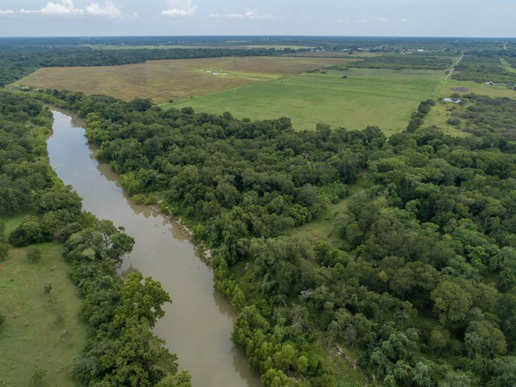 406.65 acres of optimal hunting and ag land just south of Cuero with plenty of live water and live oaks. Located on the Guadalupe River, this ranch has 7 water wells, electricity, a hunting cabin, improved pastures, and is currently home to cattle and various wildlife year-round. The water access, protective brush and trees, and plentiful food sources attract scores of whitetail deer, wild turkey, and hogs. Additionally, the river bottom provides a great place to catch catfish, bass, and the occasional alligator gar, while the ponds are an ambush spot for the waves of dove that cross between the food and water sources every morning and evening. If you are looking for a property to fish, hunt, raise cattle, or if you just want a great view, this is it!