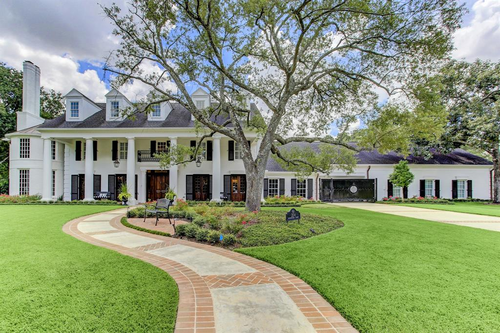Nestled on a celestial one acre setting, this home is magnificent in both scale and design. Extensive renovation to incorporate a sleek, modern intent sweeps this masterpiece. Newly refinished HWDS, fresh paint, new carpet, 2017 roof, 2018 HVAC units + much more. Gorgeous formals w/vistas of front lawn, elaborate library swathed in lavish mahogany paneling w/FP & adjoining upstairs landing & study. Magnificently alive w/light the family room dictates unrivaled beauty w/ coffered ceiling, massive FP & view of picturesque grounds & pool. Culinary kitchen boasts eat-in BKFT bar, center island & premium SS appliances. Secluded primary STE has FP & beyond opulent bath w/ boutique style closets. Theatre boasts fabulous adjoining wet bar. Temperature controlled wine room, separate apartment w/ private entry. Park-like grounds speak to a tranquil oasis for blissful family living with its sublime pool w/sauna, in-ground trampoline, playhouse & outdoor kitchen.