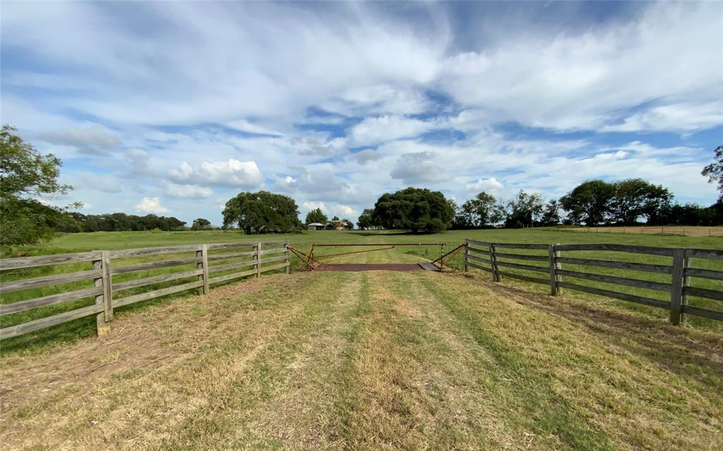 Beautiful acreage in the Lincoln area! This property has views that seem to go on forever; 2 Ponds; Dry/Seasonal Elm Creek runs through the front corner of property; Grassland for grazing or hay production; Mature large Post Oak, Live Oak, Water Oak, China Berry, Pear, Hackberry, & Crape Myrtle trees; 100% fenced, cross fenced for cattle rotation; Barn with pens, cattle chute, loafing shed, tack & equipment storage; Shed; Detached carport; & Detached garage with office on the backside. Original home needs some love & has 2 bedrooms, 1.5 baths, living, dining, kitchen, & laundry room. Electricity, Lee Co. water, septic & propane are on the property. Partial minerals negotiable. Survey available. Centrally located between Austin & College Station.