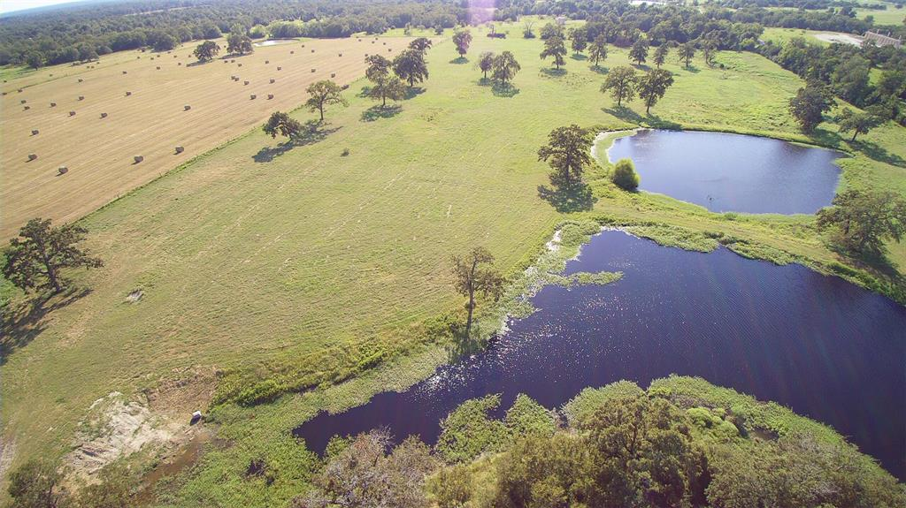 Looking to raise cattle or just relax in a pastoral setting? This ranch in Madison County will fill the bill and is situated on approximately 135.9 acres with beautiful serene views. It has both open and wooded areas with large hardwood trees as well as 9 ponds scattered among different areas of the acreage. Chose from several excellent homesites to build your weekend get-away or dream home. There are working pens and cross-fenced pastures especially designed for running cattle. Good hay production. Two deep wells, as well as community water on site. Barn/metal building on site is about 3,280 sq. ft. in size and features six overhead doors dividing the building into two large sections for workshops or equipment storage. There is also a one bedroom apartment inside with full bath and laundry.