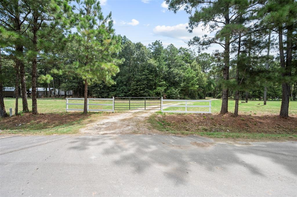 Beautiful Country property, home has a beautiful front entrance with pastures upon entrance and winding driveway that winds behind a thicket of Trees to the secluded home ready for your touches! Behind home has a thicket of trees with yard plenty for dogs or animals. Room sizes estimated buyer to verify measurements.
