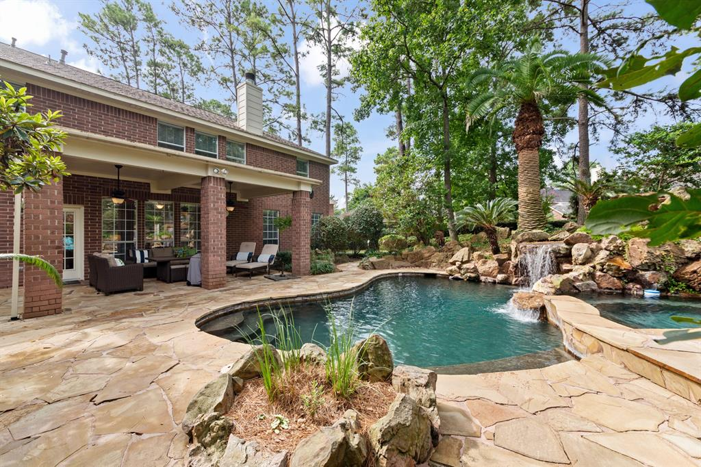 This stunning Spring residence on an oversized 17,382 sq.ft. lot with heated lagoon pool and spa surrounded by boulders and waterfalls on a quiet cul-de-sac is exactly what you've been looking for! Easy access to the Woodlands for work and shopping, close to I-45 for commuting to Downtown Houston, and zoned to KLEIN ISD, this home offers the best in location, convenience, and luxurious amenities.  Blending traditional elements with contemporary finishes and an open-concept floorplan, a large gourmet kitchen with quartzite countertops opens to breakfast area and huge family room overlooking the backyard, pool, and covered porch.  Primary bedroom suite is down with four bedrooms and game room upstairs, and flexible foyers off the grand foyer combine to meet every family's needs. Multi-width plank wood flooring downstairs. Kitchen, spa-worthy primary bathroom, and secondary baths were remodeled in 2020 and are magazine-worthy.  This one has it all - don't miss out on this Cypresswood gem!