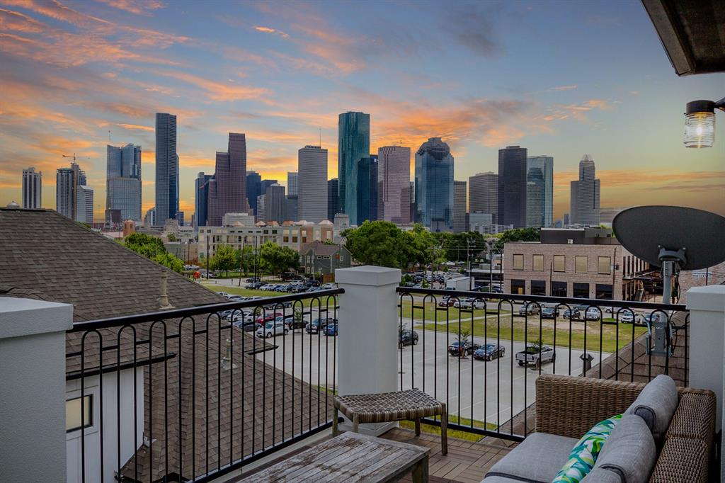 Breathtaking skyline views await in this one-of-a-kind opportunity! With beauty around every corner, you'll fall in love with this exceptional 4-story home. Relax or entertain guests in a spacious open floorplan on the 2nd level. High ceilings, gorgeous wood floors, and a gas log fireplace create a welcoming living room atmosphere. Enjoy an elegant island kitchen that features spacious granite countertops, ample cabinet space, and warm natural light. Under-cabinet lighting and a stunning chandelier add beauty and sophistication. Retreat to a lovely primary bedroom on the 3rd floor that offers a serene bathroom and spacious walk-in closet. A second bedroom and full bath rest on the 3rd floor while a third bedroom and bath occupy the 1st-floor, perfect for guests! Delight in a 4th-floor study with access to a rooftop balcony. Enjoy captivating views of a sparkling skyline with a morning cup of coffee or relax with a glass of wine under the stars on this exceptional 4th-floor haven.