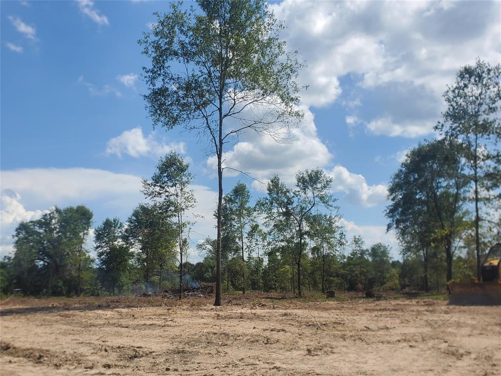 Cleared and ready for your new build or bring your mobile home on this unrestricted acreage. City Water and Power at the road and new survey provided by seller.