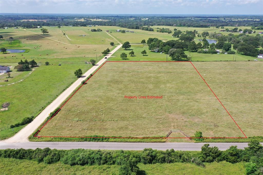 This 5.271-acre tract is ideally located for your new home in the Bellville Community.  It has frontage on both Stokes and Reinhardt Roads.  Electricity and County Water are both nearby. It has coastal grass over sandy loam soil.  Upscale homes dot the area, along with several large ranches.  Shopping is available in Bellville and Brenham and Katy is just 30 minutes away.  If you are planning to build a new home, you should look at this property. **Restricted to residential use. No manufactured homes.No Cell Towers