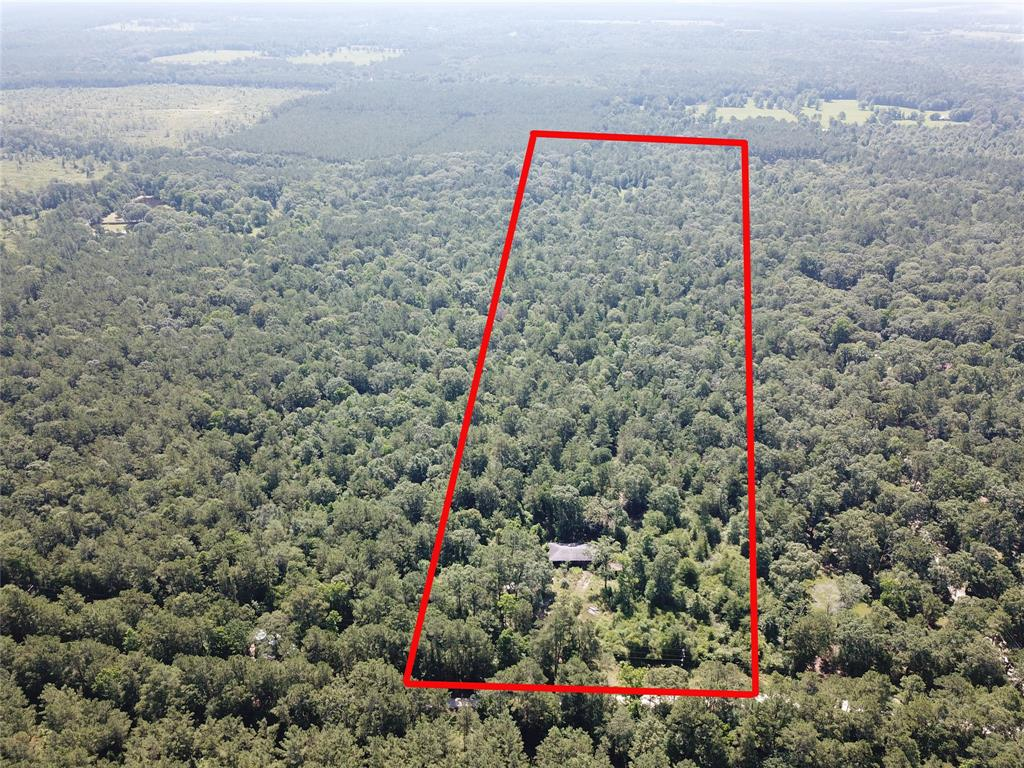 This is a nice wooded acreage tract on a county maintained road that would be perfect for a residence, weekend get-a-way or hunting and recreational use. Water and electrical service are located on the road.  There is an older home on the property that could be remodeled or torn down. These smaller tracts are hard to find and this one will not last long!