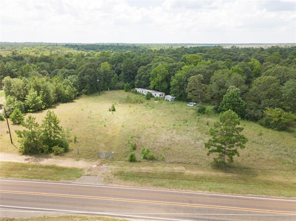 Come see this perfect sized, 5.67 +/- acres of unrestricted property, nestled halfway between Conroe and Cleveland. Whether you're looking to build your dream house, bring in a mobile home, or use for a farm, this property has what you're looking for.  Much of the property has been cleared but it still boasts nice, established trees as well.  Property already has utilities run to it as well as a septic tank and a well.  If quiet country living is your style, while still having access to nearby commerce and emergency services, this property is for you.
