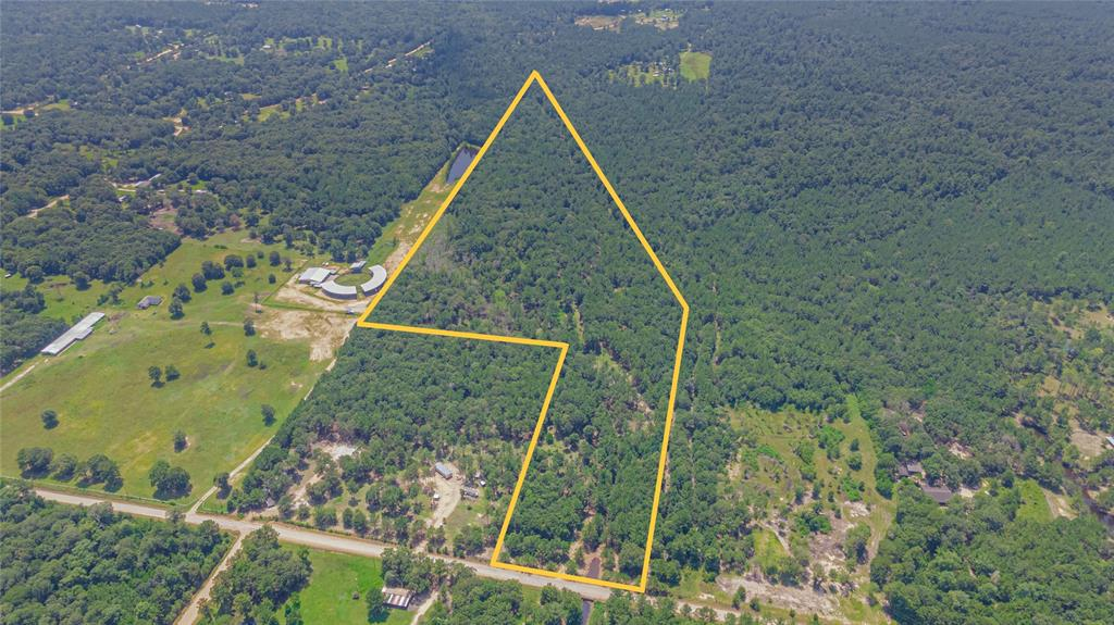 Situated in the low tax area of San Jacinto County, this gated property boasts 32.55 acres of densely wooded mature land and is priced to sell! This property is unrestricted and can be used to build your dream home, leisure ranch, or almost anything else! Property comes fenced with barbed wire fencing placed about 30-80 feet within the actual property line, and features a small metal pole barn covering for the cattle and other animals to take shelter under during inclement weather. Located less than an hour away from Lake Conroe and Lake Livingston, this property offers privacy PLUS ease of access. Schedule your private tour today.