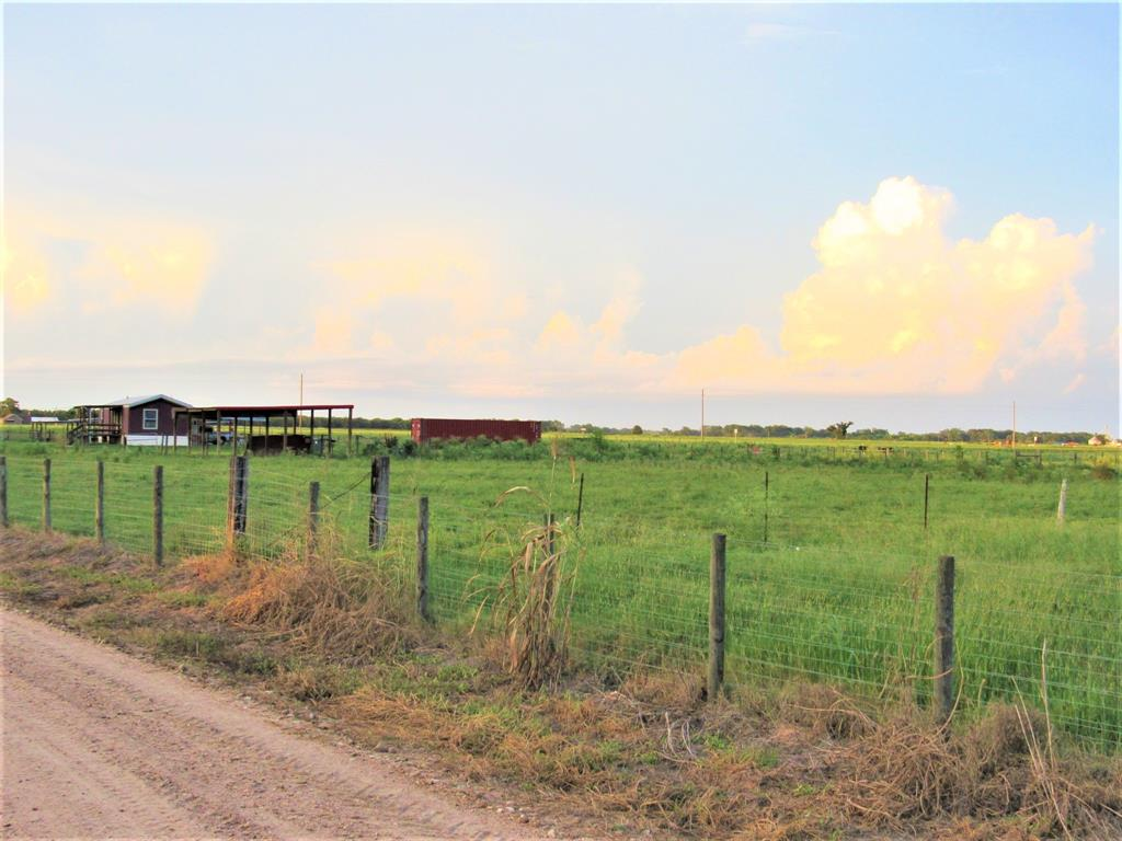 This is a beautiful 12.23 acre cattle/horse property that is fenced and cross fenced, has a round pen with cattle shoot, multiple gates, 2 covered areas for cattle shelter, water well, 2015 mobile home with carport and aerobic septic.   Make this place your dream home, ranchette, build a dream home or whatever you desire.  This property has no restrictions so do whatever you want.   This property sits on the corner of fm 2614 and CR 267 in the Eagle Lake zip code but is in Wharton County and is served by the highly accredited East Bernard School District.  Property is agriculture exempt making the monthly payments lower.  Call fast, this one is a nice one.