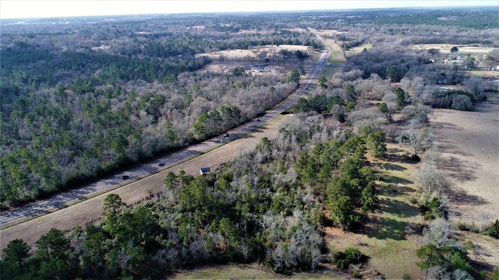79.219 ACRES!   This large tract is located on Loop 304, with approximately 1,400 feet of frontage on Loop 304. This property would work for a wide range of uses and developments and has a nice sized pond. There is nearby shopping, restaurants, and commercial businesses. Houston County is a growing area in East Texas conveniently located 100 miles North of Houston and 140 miles South of Dallas. Call us today to schedule a private tour of this great property. Owner is willing to subdivide property!