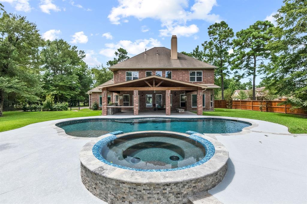 Beautiful home in Benders Landing with your own private oasis located in a cul de sac. The backyard is an entertainer's dream with over a 800 square feet of the covered patio area, a large outdoor kitchen, gas fire pit, and a gorgeous heated saltwater pool and spa. The office has built-in with french doors. The large family room with an open concept to kitchen/breakfast area, which offers plenty of entertainment space. Chefs dream kitchen with plenty of cabinet space, stainless steel appliances, pot filler, and much more. Spacious master suite with wood floors and an en suite bath with jacuzzi tub. The room downstairs could be flex or 5th bedroom which has a built-in closet. Hidden room located downstairs for storage. Upstairs has new carpet with three large bedrooms and a gameroom. Electric vehicle ready with a Nema 14-50 outlet and a full home surge protector. Located close to all schools, I-99, I-45, Hardy Toll Rd, new movie theater, and new restaurants.