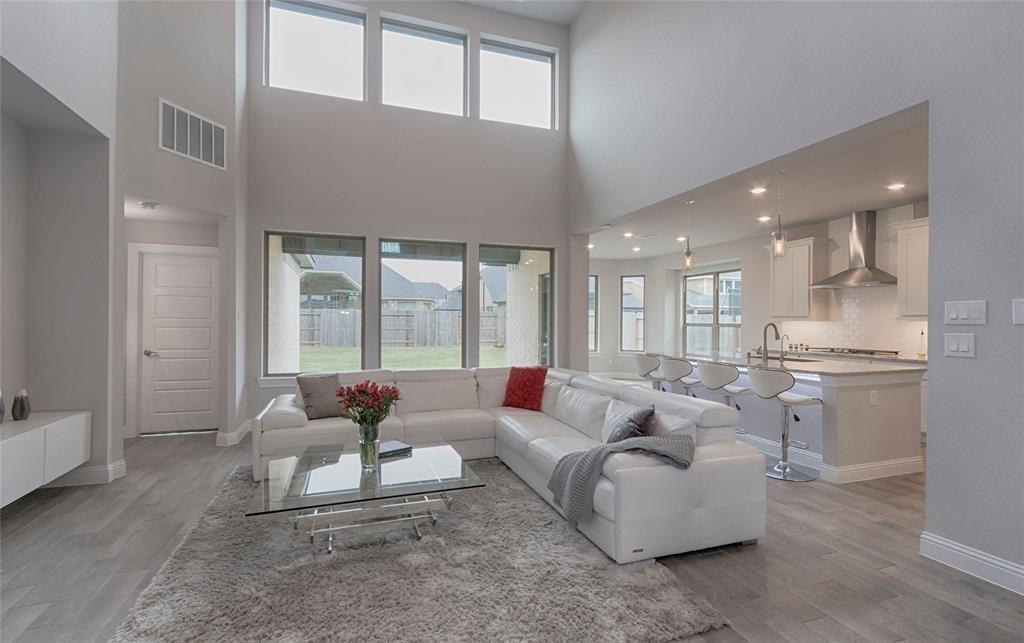 MUST SEE! Beautiful M/I home in Young Ranch. This stunning home was built in 2019 and has lots of upgrades. Downstairs, the home offers a high ceiling with an open floor plan. The family room is spacious, yet cozy, and displays an inviting gas log fireplace, a built-in entertainment nook, and large open windows which provide plenty of natural lighting. The gourmet kitchen has stainless steel appliances, granite counters, a built-in gas cooktop, a spacious pantry, and plenty of cabinets for storage. You'll also notice the modern-styled wood tile throughout the first floor.  This home also has a study and formal dining room. The primary bedroom is spacious and the primary bathroom spoils with double sinks, a soaking tub, and a walk-in seamless shower. Upstairs, you'll find three generously sized secondary bedrooms; two of which share a Jack & Jill style bathroom. You'll also find a spacious media room, and a game room for your family to enjoy.  The home also has a covered back patio.