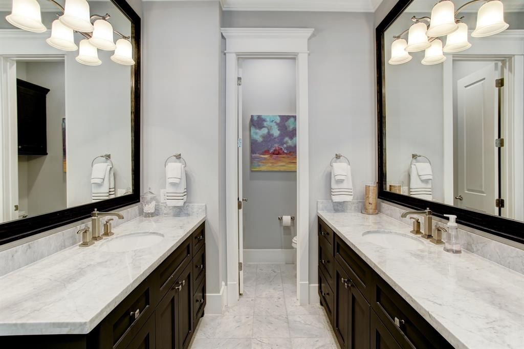The primary bath is nothing short of a world class spa environment with light granite countertops, separate vanities and a private water closet.