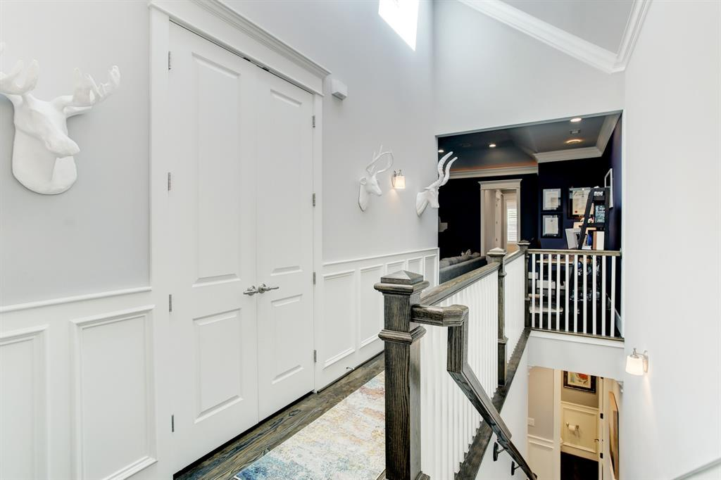 At the top of the stairs behind these double doors is an extra deep side-by-side laundry closet.