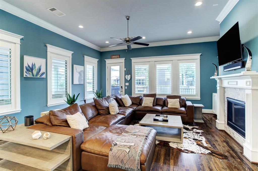 Upon entering this property you'll be immediately impressed by the fine finishes including plantation shutters throughout, the layout and lots of light. At the back left of this photo of the first level living room is the door leading to the covered back porch and impressive yard.