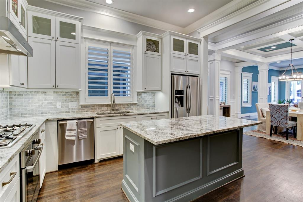 The kitchen island includes an overhang for stool seating.