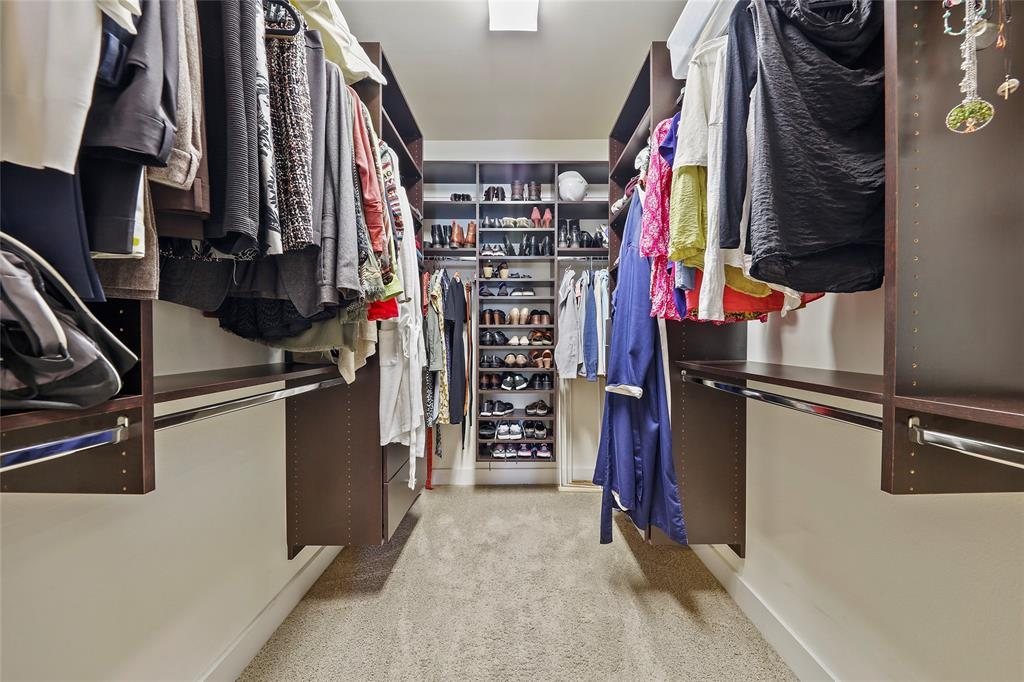 The walk-in closet in the primary suite features built-in storage.