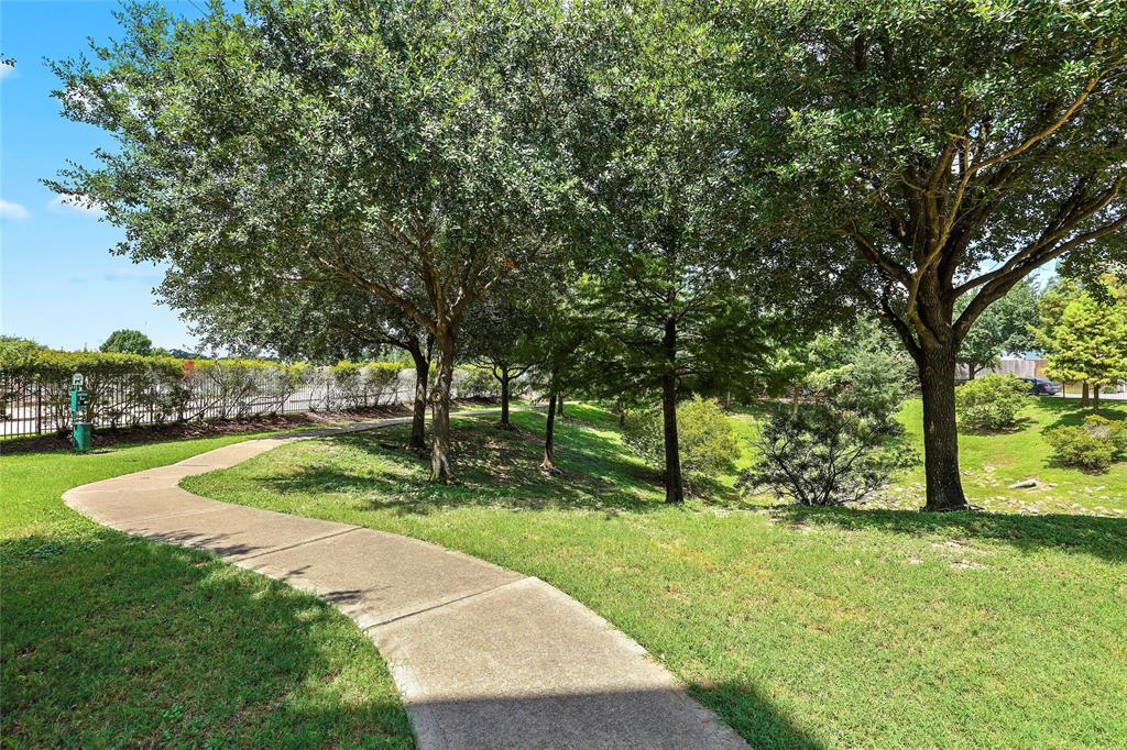 This gated community has a private walking path & courtyard.