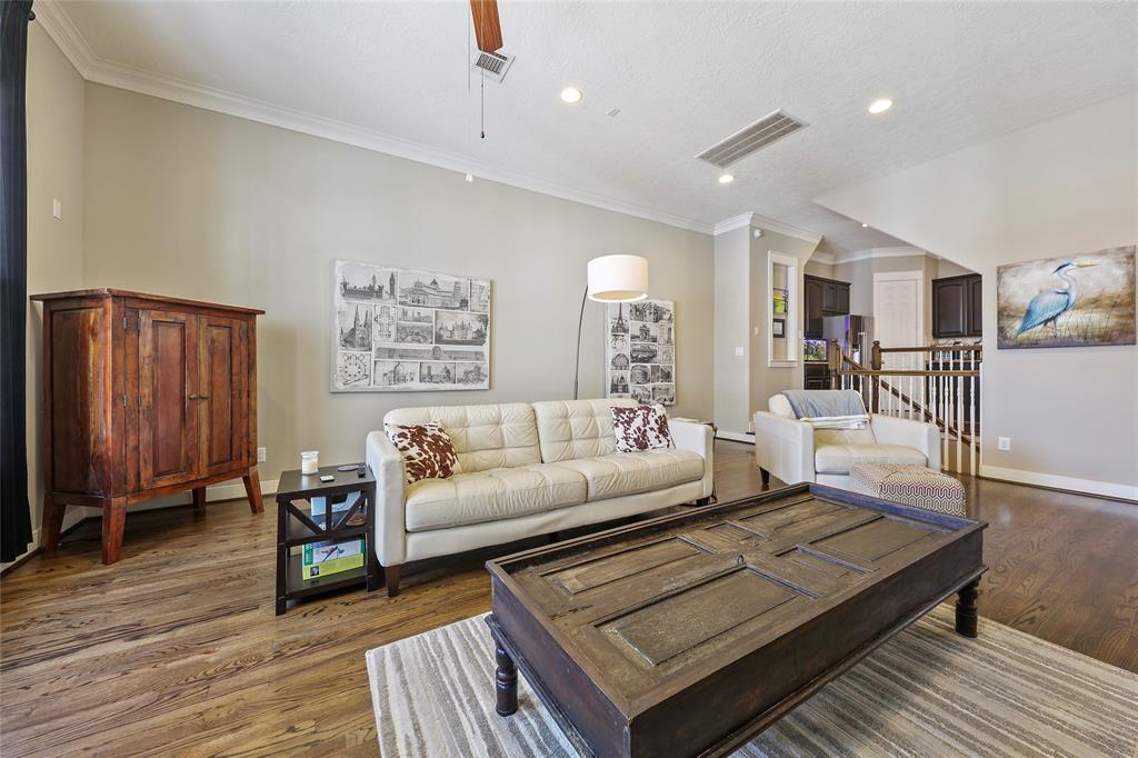 The living room features wood floors crown molding.