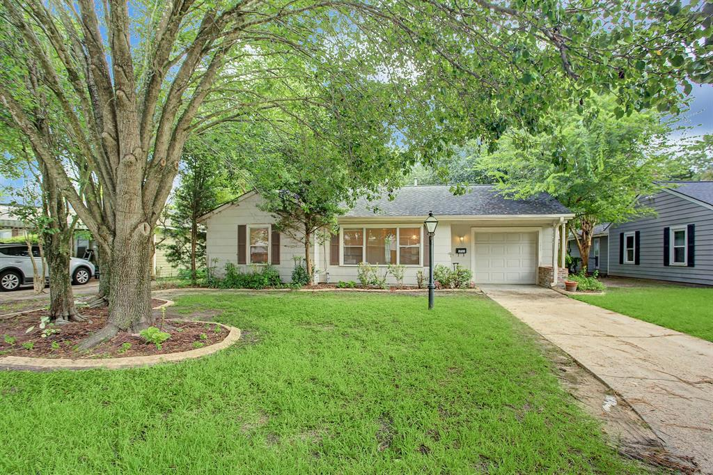 Lovely home in highly-desireable Oak Forest East on wooded lot