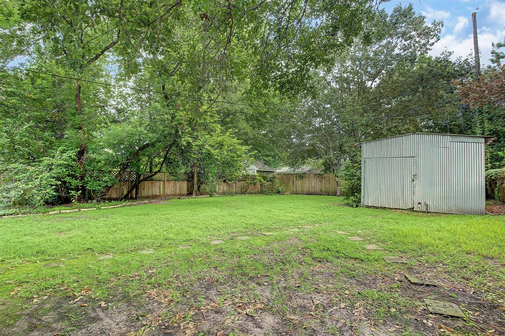This workshop aka storage shed is in good condition and could be a real asset for the next home owner. There really are trees everywhere you look!