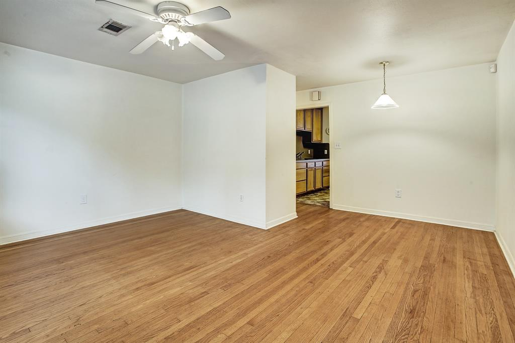 Pretty hardwoods viewed from the entry. Living room/dining room combination lead to the hallway and the kitchen