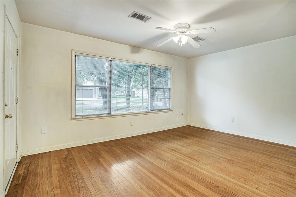 House entry leads directly into this front living room overlooking wooded, landscaped front yard.