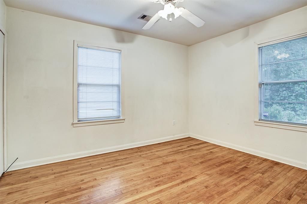 Windows, a closet, attractive wood floors and a ceiling fan in each bedroom.