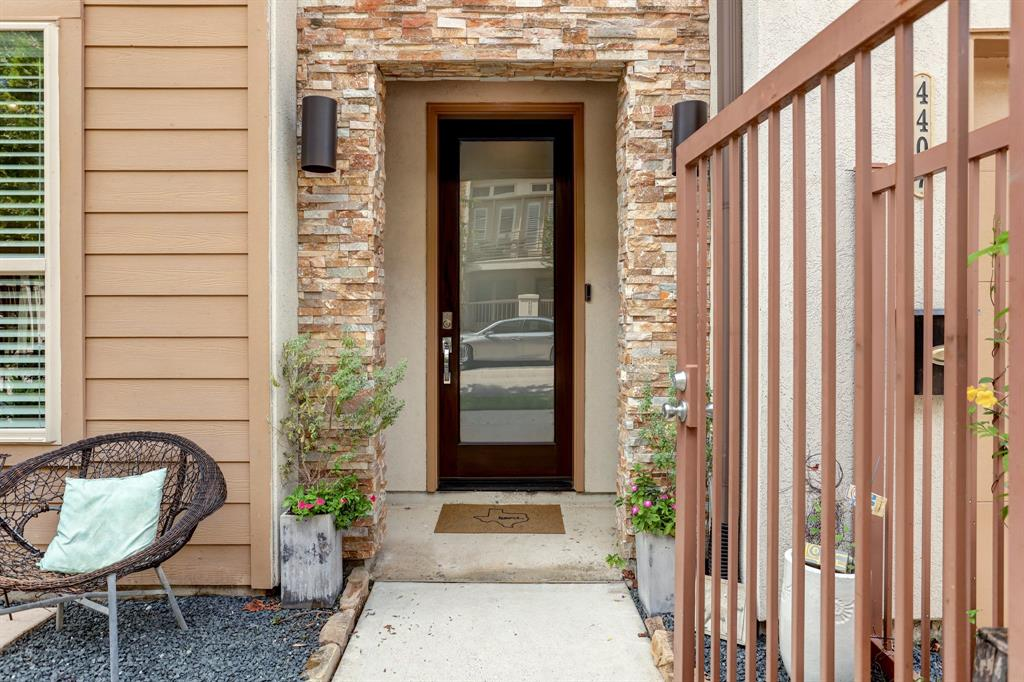 This free standing, 4 story home has the perfect layout for entertaining.  The home is freshly painted and has a new roof (7/21).  The first floor features an en-suite bedroom (currently being used as a salon).  The 2nd floor's living areas are open and inviting.  The cook's kitchen has a huge granite island and Bertazzoni Stainless Steel appliances.  The dining room lies between the kitchen and living area and the 3rd floor is dedicated to the Primary suite and utility room. The 4th floor has an en-suite 3rd bedroom PLUS a huge game room that leads to your roof top terrace with downtown views.   Only ten minutes away from downtown with lots of restaurants, shops and the neighborhood H-E-B even closer.  There are NO HOA fees and you even get a small fenced in front yard!