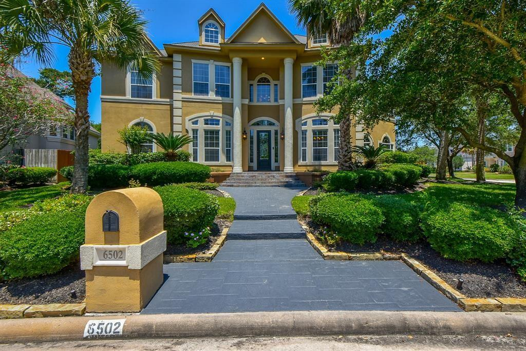 Nestled in a gated community of spacious custom built dwellings, this gorgeous Mediterranean stucco home encompasses 5,724 square feet of spacious luxury living. Stunning interior views, accentuated with a plethora of built in features, high ceilings and towering windows provide a well deserved feeling of affluence. Showcase your culinary cuisines in this kitchen designed from the influence of local chefs - granite counter tops, double ovens, commercial refrigeration, island cook tops. Experience a relaxing evening routine in the master bathroom with separate sinks, oversized shower and a custom contemporary free standing bathtub. Your home backs up to a green belt which allows for a relaxing, private enjoyment of your oversized back yard living area, complete with a covered outdoor kitchen. Walking distance to highly rated Klien ISD schools, museum, library, police station/court house, parks, hike and bike trails, and local cuisine. This is a very active swimming and tennis community.