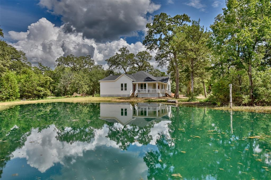 What a perfect location. An amazing early 1900's farm house fully renovated on 3 acres outside of New Ulm. One of the most sought after areas in Austin County sits this amazingly restored home. The house was almost totally redone with all improvements that are a must. What was replace? Roof, exterior, insulation, windows, doors, plumbing and electric. Gloriously updated kitchen and the two and half baths give you all the modern accommodations. Through out the house are the original wood plank floors and shiplap walls so that you keep the original feel and look. Enjoy the peace and tranquility sitting on the large covered porch overlooking the beautiful pond. It doesn't get more relaxing than this.