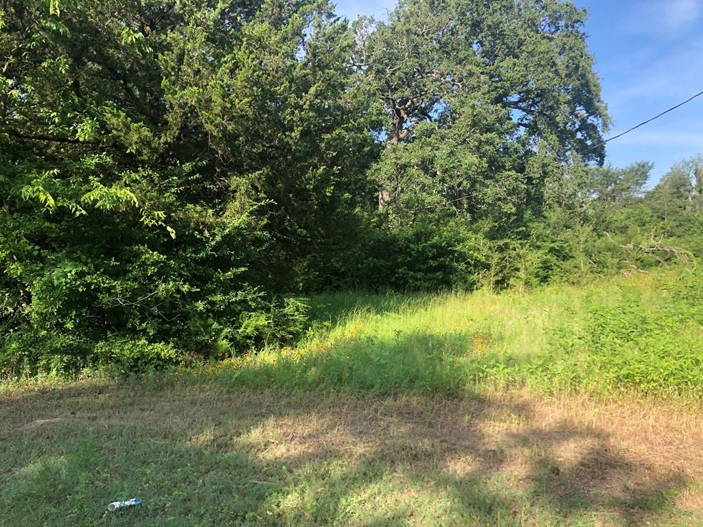 1.12 acres located at the edge of Marquez with city water and city sewer available. Wooded with deer and other wildlife roaming all around this area. Good level ground. Not in the flood plain.  Additional acreage available for purchase. Great homesite!
