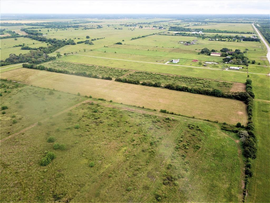 Unrestricted and AG Exempt! Road frontage on FM-2004. Nice rectangular shape, new culvert, Fenced, new survey and electricity along FM-2004. Additional tracts available, 16.52 & 23.53 acres Call today!