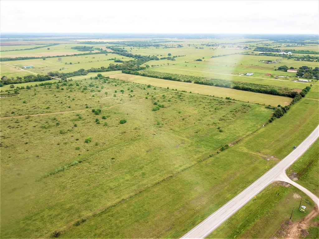 16.52 acres prices at $379,900, $22,996/Acre, Unrestricted and AG Exempt! Road frontage on FM-2004. Nice rectangular shape, new culvert, new survey and electricity along FM-2004. Additional tracts available, 10.3 and  23.53 acres Call today!