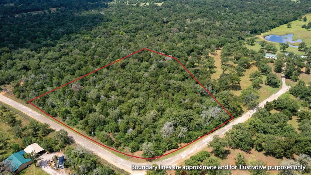 RARE FIND! 6 wooded acres of unrestricted land in the Dime Box area.  This corner tract allows you to customize your dream homesite with water and electricity available in the area! Call today to schedule your private tour!
