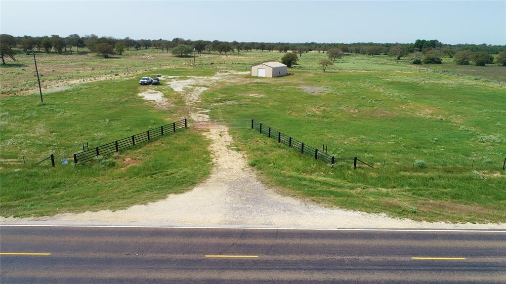 13.78 +/- Acres to be surveyed out of a larger parcel. Just north of Flynn, TX. Roughly 475' of frontage on FM 39. Public water, electric, sewer and a 30X40 metal shop. This property is ready for someone to build the home of their dreams. Beautiful pipe entrance and large parking area already rocked, pipe roping pen in the back. Lots of potential here, properties like this are hard to find. Must See!! Contact listing agent with any questions.