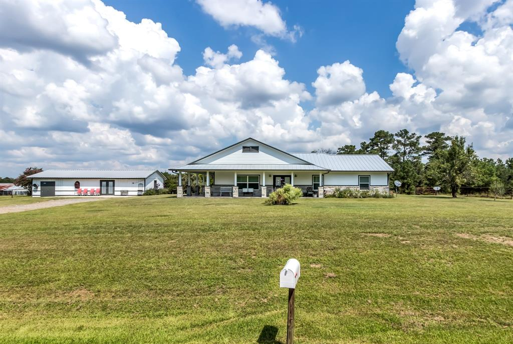 Check out this beautiful 3 bedroom, 2 bath country home in the desired Anderson-Shiro school district! Enjoy quiet county living with quick access to HWY 105 and the new 249 Tollway. The home was brought down to the slab in 2018 and completely reconstructed with additional square footage added. This home features an inviting open floor plan with wood tile flooring, quartz countertops, large island, stone fireplace and custom cabinets & built ins throughout. The master suite is stunning with his and her closets, oversized walk-in shower, quartz countertops and separate vanities. New PEX plumbing, electrical, spray foam insulation, standing seam metal roof, water well, and aerobic septic were also included in the remodel. Outside you'll find a completely tiled wrapped porch to enjoy the view! The detached building features a 20' x 35' bonus space with a half bath, kitchenette and attached storage room. The property also has a fenced pasture area and small pond.