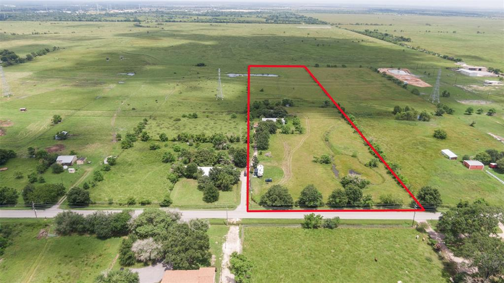 10 acres already cleared and unrestricted.  With approximately 290 ft of road frontage, this property has endless possibilities for business, residential development, investment, hobby farm, ranching etc.... property is currently pasture land, AG exempt and used to run cattle and hay.  Pond is fed year round.  Barndominium was damaged in the freeze and needs to be repaired. 250' foot water well provides water even in the most dry seasons. Would be excellent as a personal residence, office, or clear it out and use as a shop.  Also available is the neighboring 10 acres, if one piece just isn't enough.  Call listing agent with any questions.  Please contact the listing agent for your private showing.